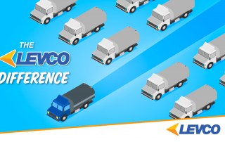 The Levco truck driving past several generic trucks.